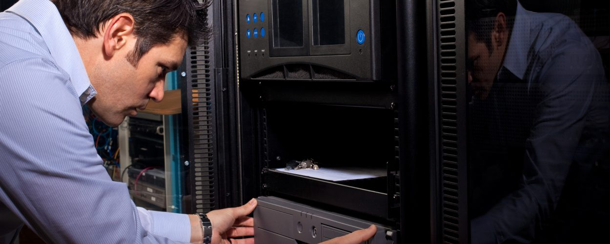 An IT systems administrator installs hardware in a computer network server